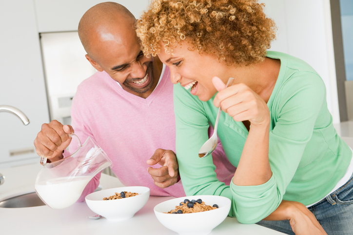 African American couple eating cereal