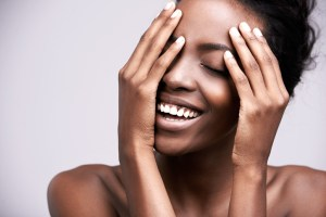 African American woman happy clear skin