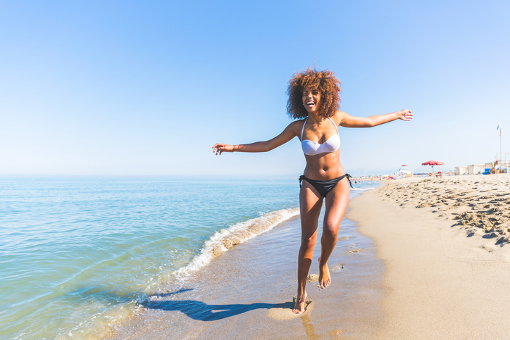 African American woman on the beach natural hair