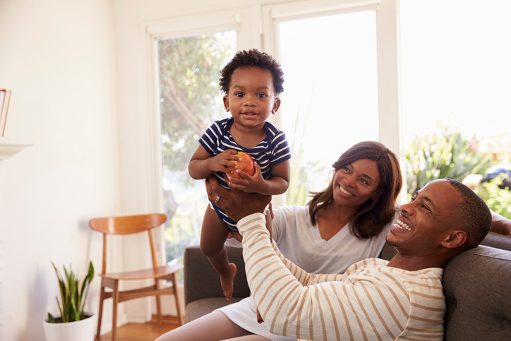 African American parents with happy baby