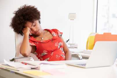 African American woman sleeping at work