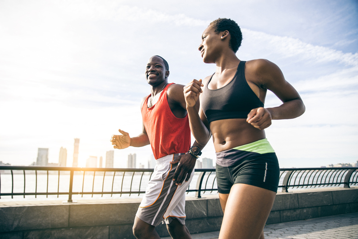 African American couple running
