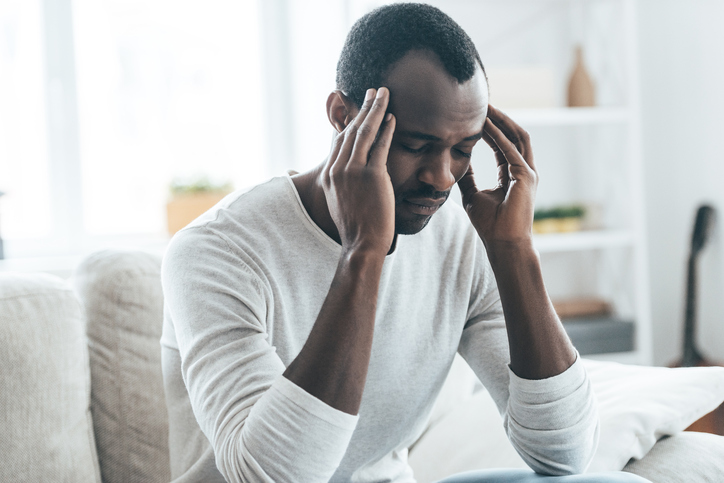 African American man headache stressed
