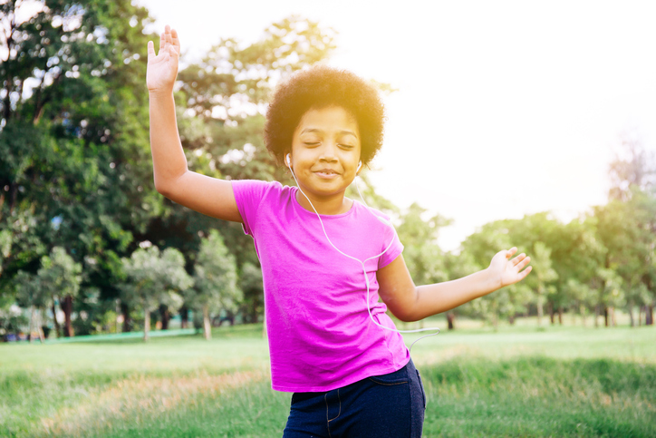 African American girl dancing happy outside