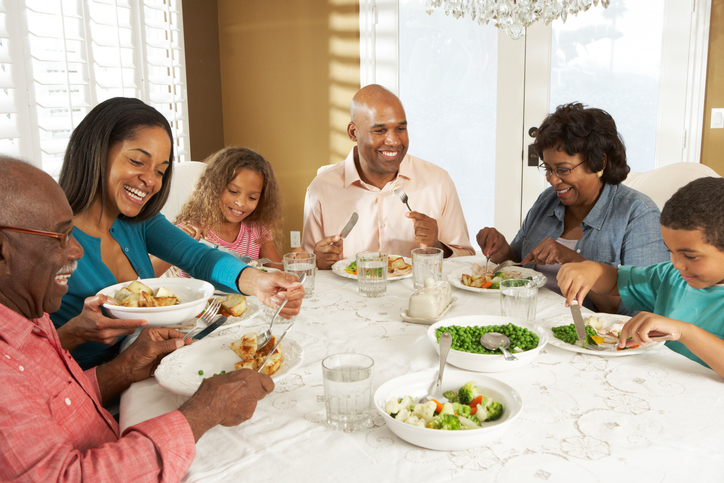 African American family eating meal