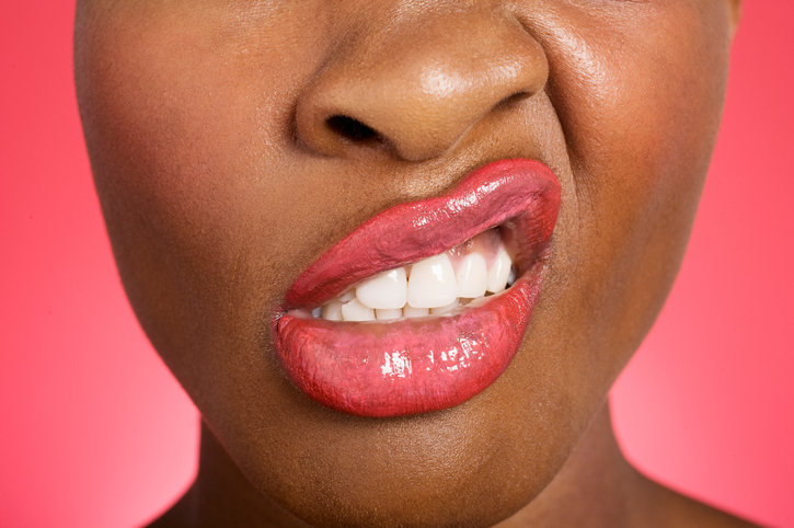 African American woman with lips twisted