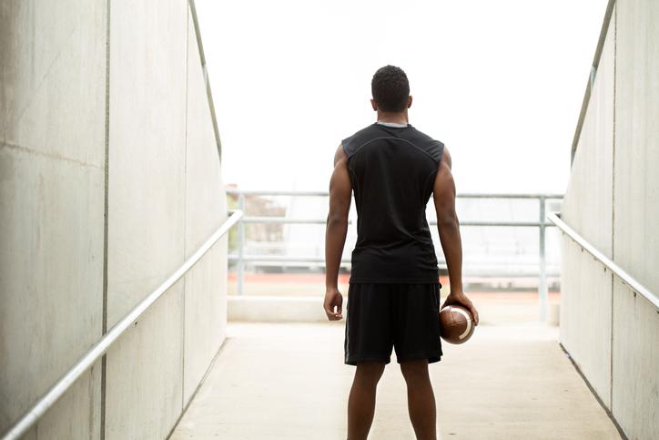 African American teen football player