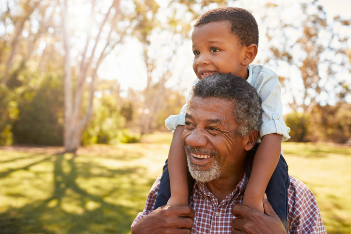 African american grandfather with grandson outside