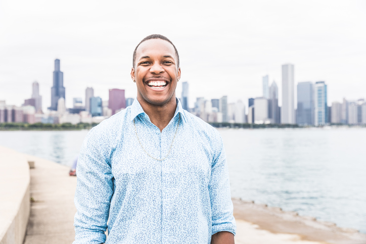 African American man smiling outside white teeth