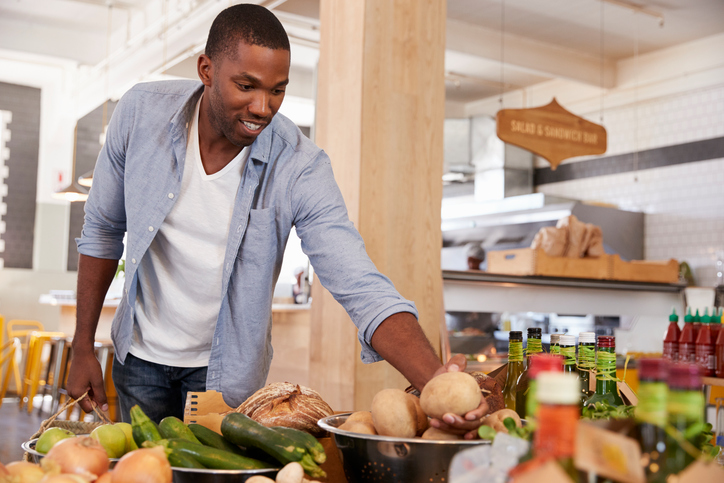 African American man grocery shopping