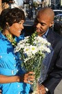 african american woman receiving a bouquet of flowers from an african american man