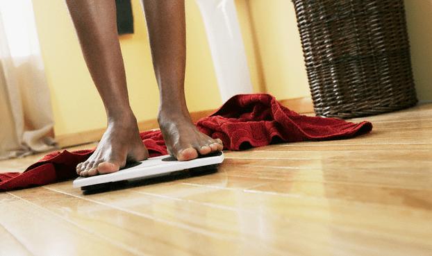 A man's feet on a scale
