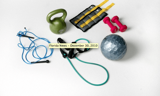 A group of workout tools lying on a white surface
