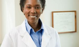 A dermatologist smiling