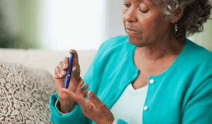 A diabetic woman testing her blood glucose level