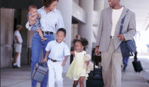 A family walking outside to an airport