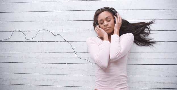 A woman listening to music on the floor