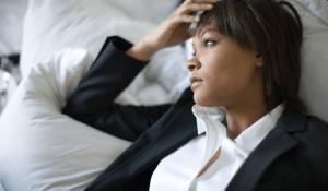 A businesswoman resting against a pillow