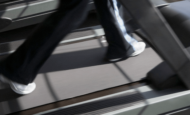 A woman walking on a treadmill