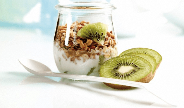A yogurt and granola in a glass jar