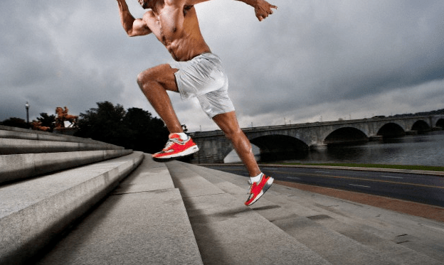 An athlete running up a flight of stairs