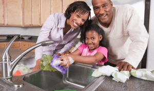 A family cleaning their kitchen