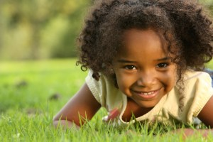 african american girl in the grass