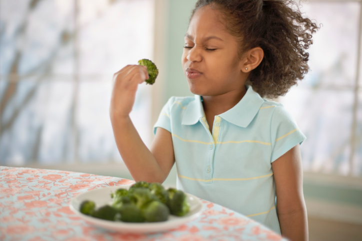 child eating veggies