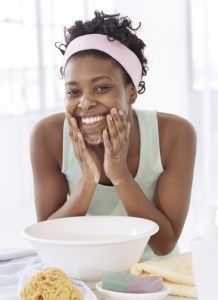 young woman washing face by face bowl