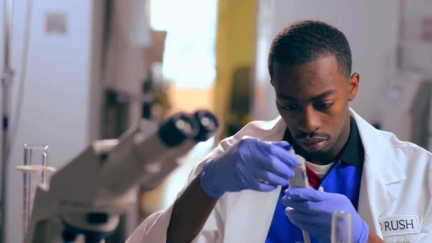 black man looking at testing tube