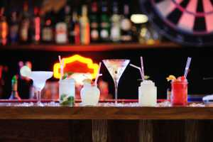 six cocktails on a bar