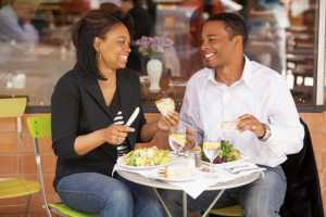 young african american couple eating at a restaurant