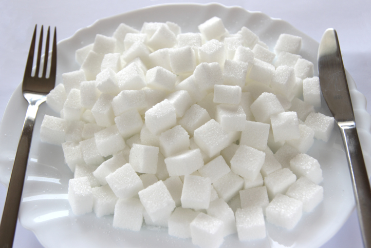 Sugar cubes on plate