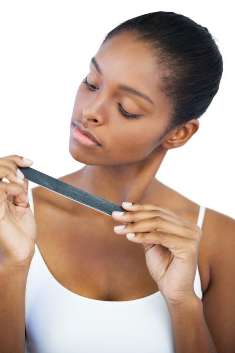 woman examining nail file