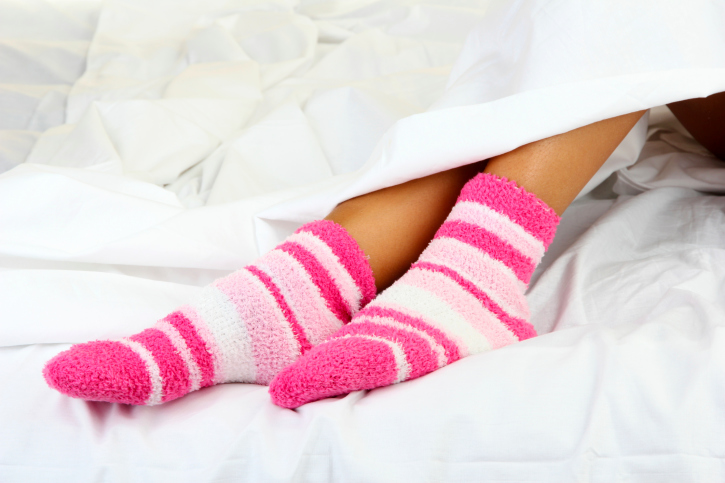 woman in bed socks