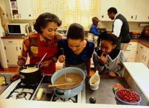 Women Cooking Thanksgiving Gravy