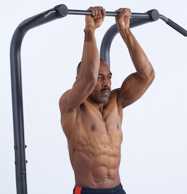 african american man doing closed hand pull up