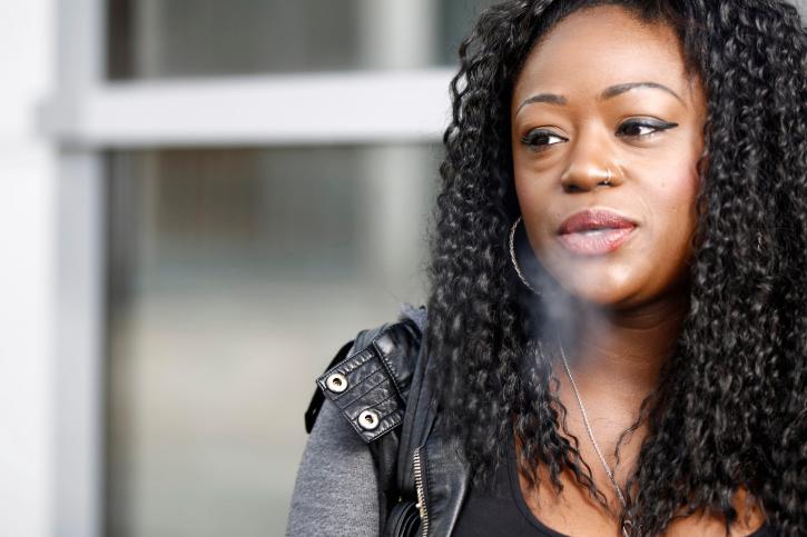 woman blowing cigarette smoke