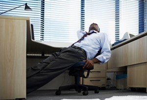 African American Black man bored tired at work office