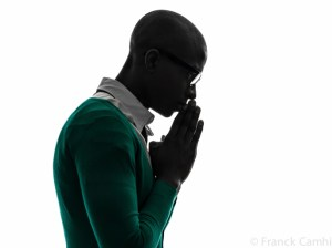 african black man thinking pensive praying silhouette