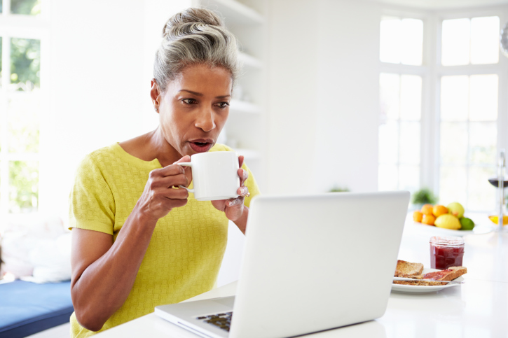 older woman coffee laptop