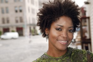 portrait of a smiling urban woman outdoors