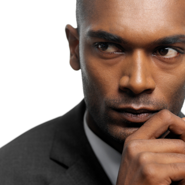 Close-up of a young businessman looking sideways