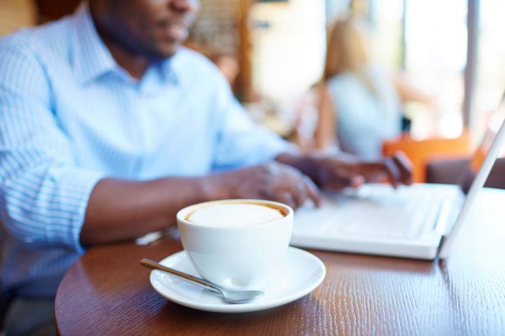 man laptop coffee shop