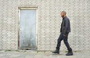 african american man walking outside
