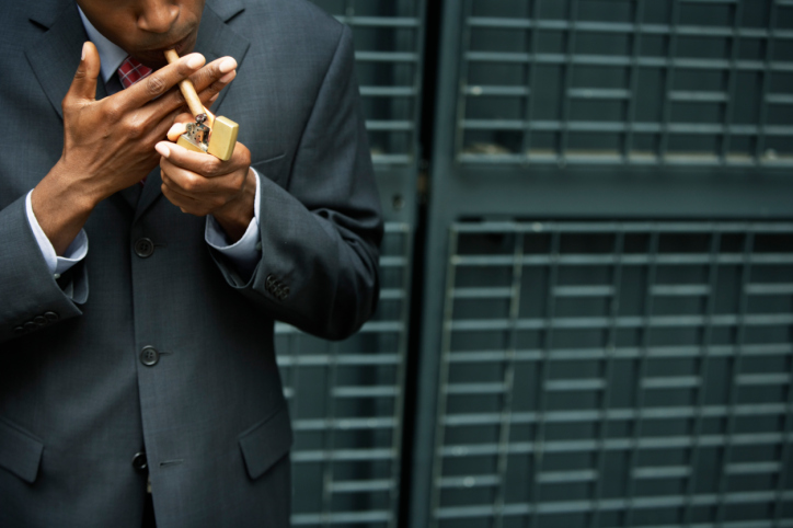 business man smoking cigar