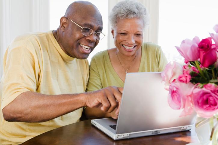 older couple sharing laptop