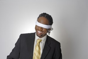 smiling blindfolded african american businessman