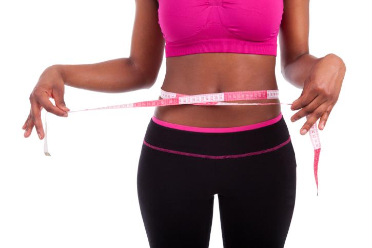 woman measuring waist full