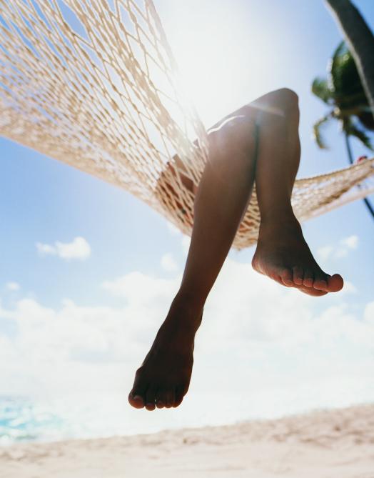 womans legs hammock on beach